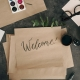 Welcome written in brush calligraphy