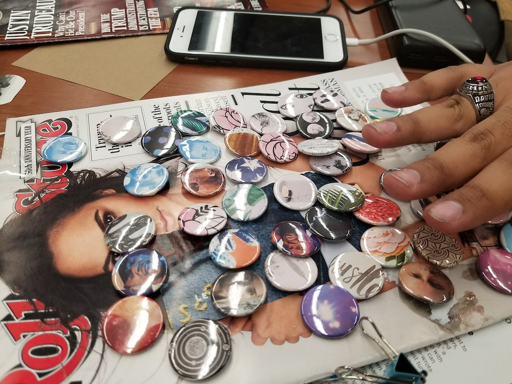 Mini buttons waiting to get finalized on top of a magazine cover