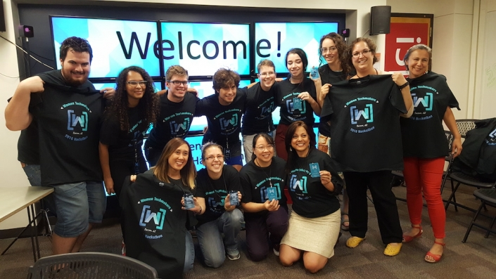 A group of smiling people at the UA Women's Hackathon