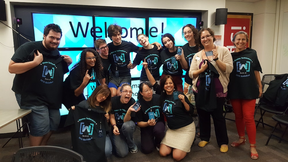 A group of people making silly faces at the UA Women's Hackathon