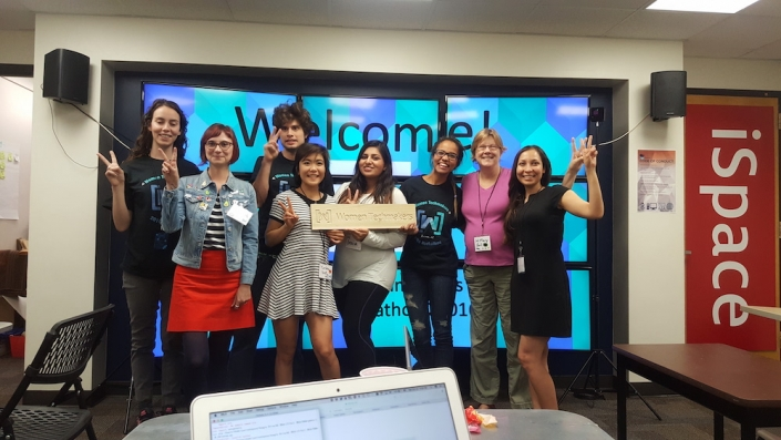 A group of people standing together at the UA Women's Hackathon