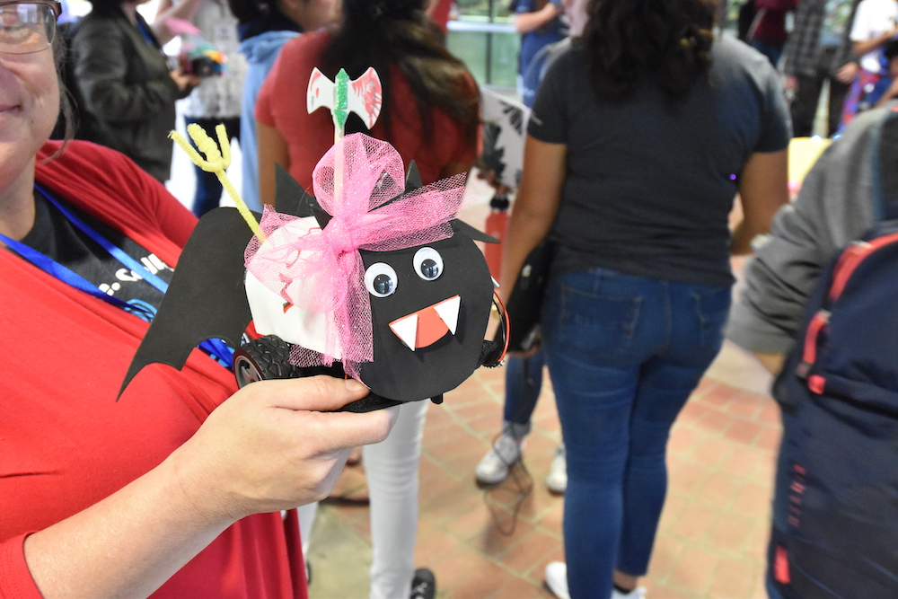 Someone showing off a creative project at the UA Women's Hackathon