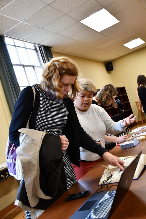 People looking at objects at the Bibliocircuitry: Old Books, New Stories showcase
