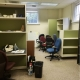 The lab space filled with cubicles, chairs, bookcases, and other furniture
