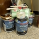 Cans of paint and painting supplies